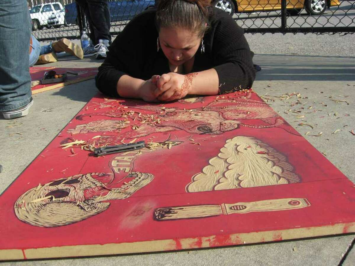 Artists and students from various universities around the country gathered on Crockett Street in downtown Beaumon on Nov. 19 to make large-scale prints as part of Steam Roller Madness. Teresa Mioli