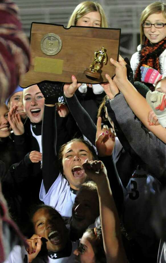 Shelton team members cheer as they hold up the trophy after beating Westhill in Class LL girls final championship soccer in Norwalk, Conn. on Friday November 19, 2010. Photo: Christian Abraham / Connecticut Post