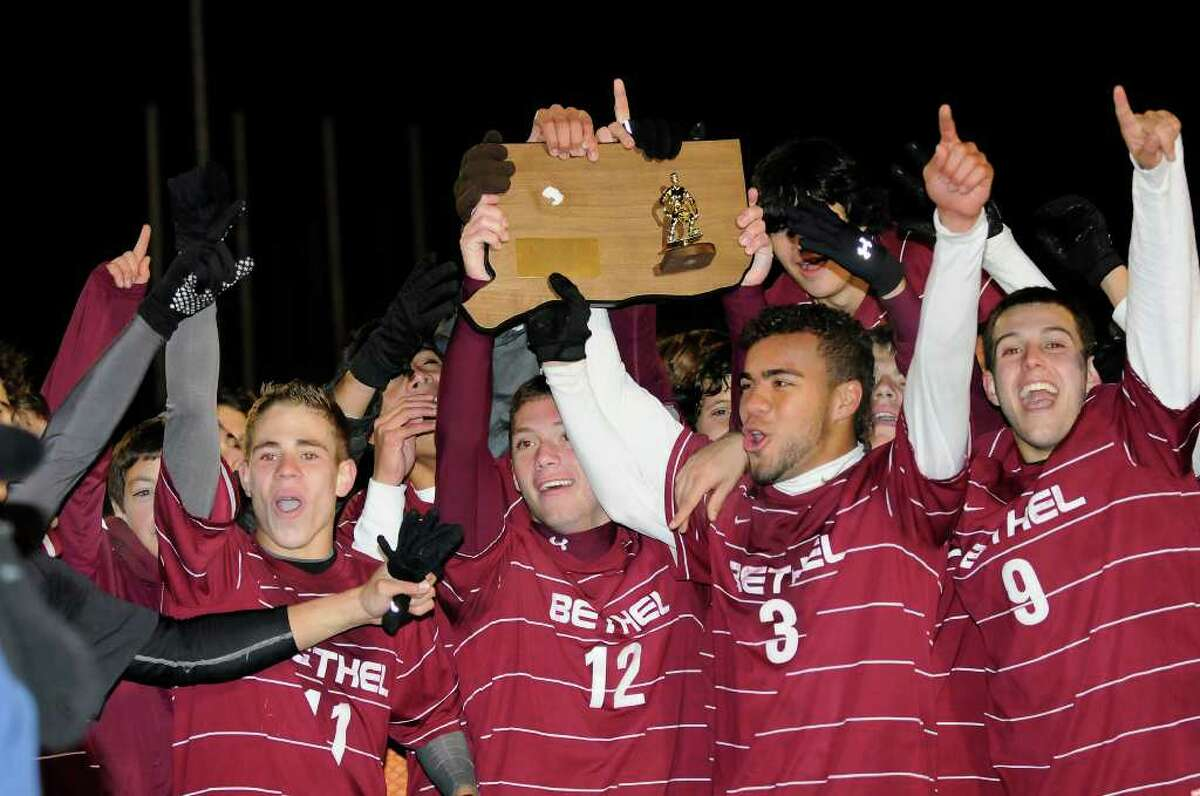 After 40 minutes of extra play leads to a one-one tie, Bethel High School shares the state championship with Montville High School for the Class M Finals boys soccer state tournament at Ken Strong Stadium at West Haven High School in West Haven, CT on Friday November 19, 2010.