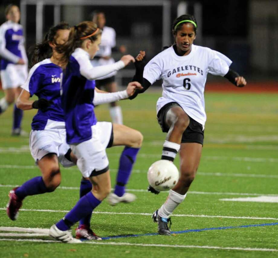 Highlights from Class LL girls final championship soccer match between Shelton and Westhill in Norwalk, Conn. on Friday November 19, 2010. Shelton's #6 Sonali Rodrigues, at right. Photo: Christian Abraham / Connecticut Post