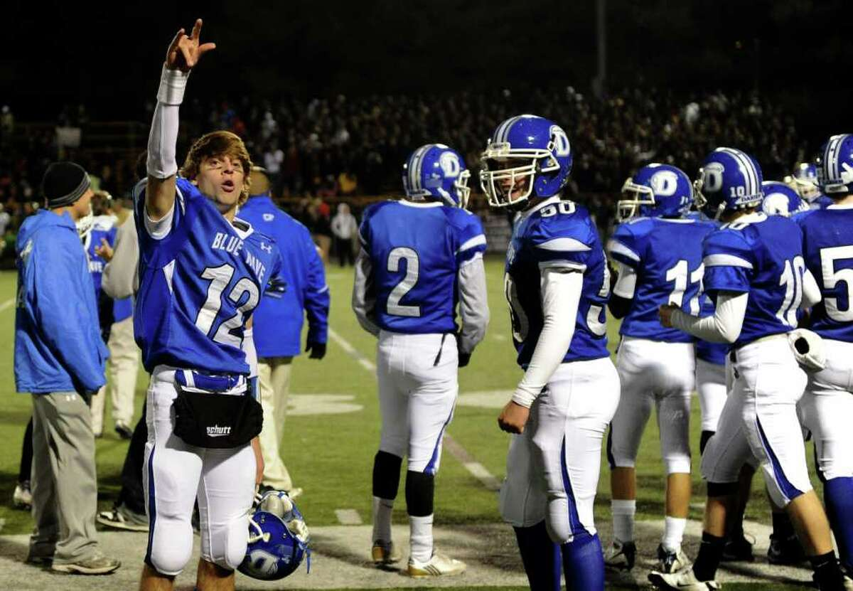 Darien's Chris Allam puts a hand up to the crowd when it is clear Darien won Friday's FCIAC football championship game at Trumbull High School on November 19, 2010.