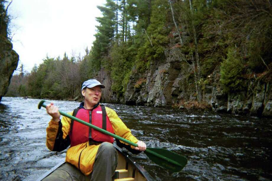 Phil Brown, the editor of the Adirondack Explorer, is the target of a lawsuit by private landowners claiming he paddled on an Adirondack creek they contend is closed to use by the public. (Associated Press archive) Photo: MICHAEL VIRTANEN / AP