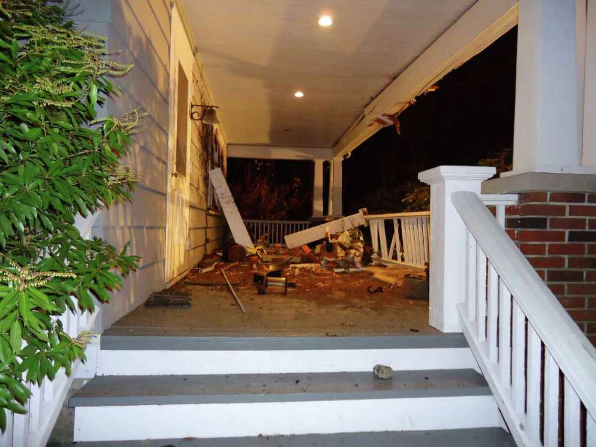 The driver of a Porsche Carrera was trapped for 40 minutes after going airborne for 35 feet and crashing into a house at 24 Highland Ave. in Rowayton late Friday night.
