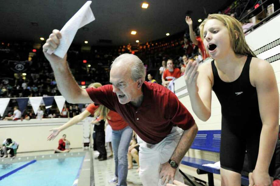 Greenwich High School swim coach Dick Hawks urges on one of his GHS swimmers poolside during the CIAC State Open Girls Swimming Championship at Yale University, New Haven, Conn., Saturday afternoon, Nov. 20, 2010. Photo: Bob Luckey / Greenwich Time