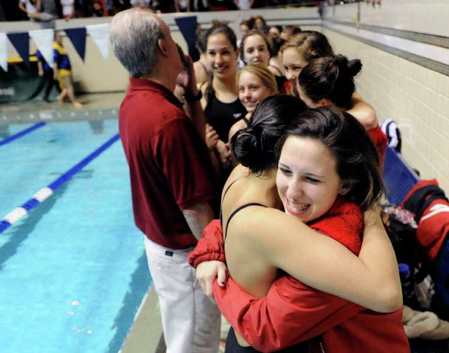 Haley Sylvester of GHS hugs a teammate after the Greenwich High School girls swim team won the State Open during the CIAC State Open Girls Swimming Championship at Yale University, New Haven, Conn., Saturday afternoon,  Nov. 20, 2010. Photo: Bob Luckey / Greenwich Time