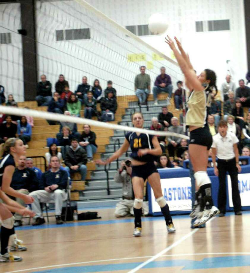 Joel Barlow's Rachel Schenck goes up for a block during Saturday's Class M volleyball final against RHAM. Photo taken Saturday, Nov. 20, 2010. Photo: Rich Gregory / The News-Times