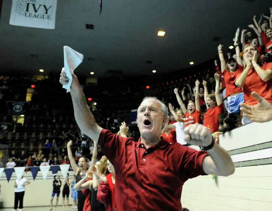 Greenwich High School girls swimming coach Dick Hawks reacts as his GHS swim team won the State Open Championship after the final event during the CIAC State Open Girls Swimming Championship at Yale University, New Haven, Conn., Saturday afternoon, Nov. 20, 2010. Photo: Bob Luckey / Greenwich Time