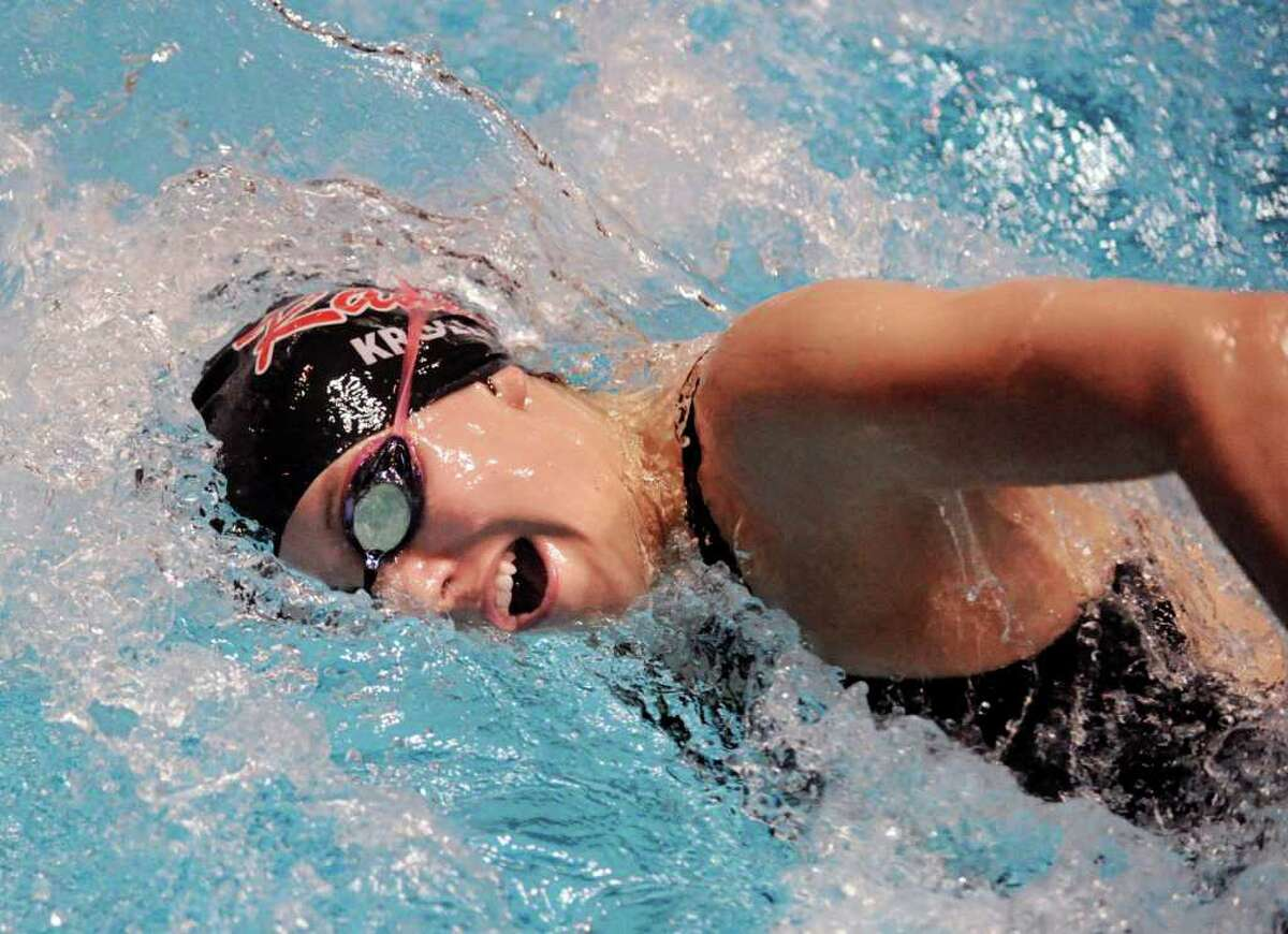 Olivia Kroll of New Canaan High School competes in the final heat of the 400 yard freestyle relay during the CIAC State Open Girls Swimming Championship at Yale University, New Haven, Conn., Saturday afternoon, Nov. 20, 2010.