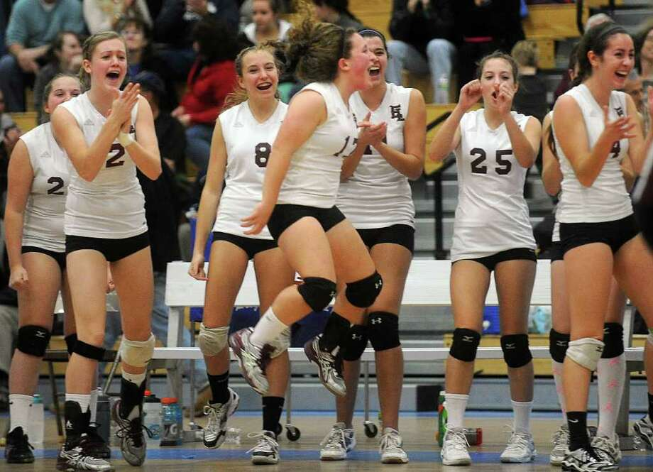The East Lyme girls volleyball team celebrates winning a game during Saturday's Class L Volleyball Championship game against Darien at Glastonbury High School on November 20, 2010. Photo: Lindsay Niegelberg / Connecticut Post