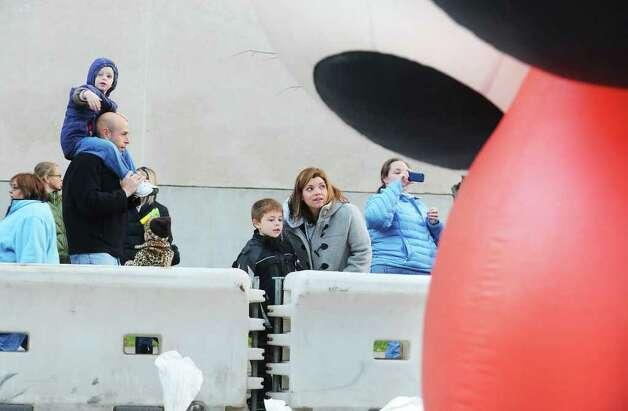 Carla Bick and her son David Bick, 6 of Stamford, walk by Elmo at the SAC Capital Advisors Giant Balloon Inflation Party on Hoyt Street in Stamford, Conn. on Saturday November 20, 2010 in preparation for Sunday's UBS Parade Spectacular. Photo: Kathleen O'Rourke / Stamford Advocate