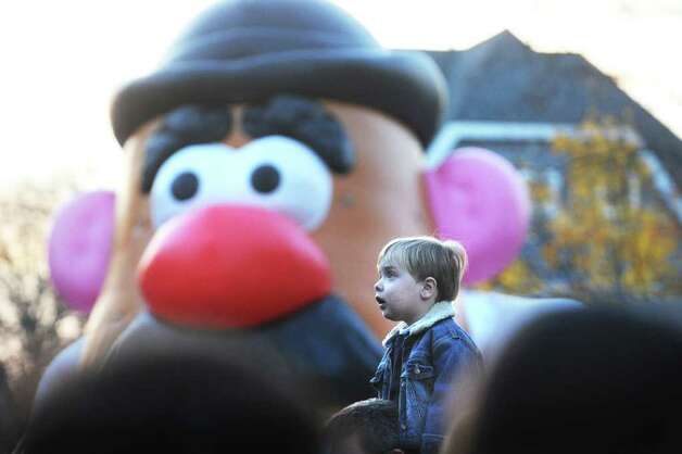 Henry Sandor, 3 of Greenwich, watches with wide eyes as the balloons come to life at the SAC Capital Advisors Giant Balloon Inflation Party on Hoyt Street in Stamford, Conn. on Saturday November 20, 2010 in preparation for Sunday's UBS Parade Spectacular. Photo: Kathleen O'Rourke / Stamford Advocate