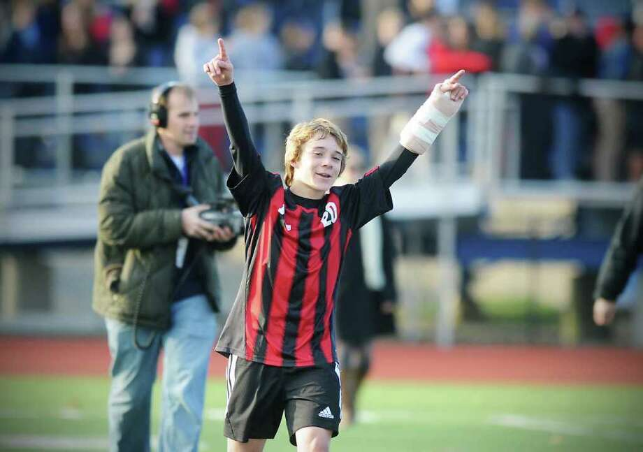 New Canaan's Steven Valente celebrates his teams win over Bunnell in the Class L boys soccer championship match at Fairfield Ludlowe High School in Fairfield, Conn. on Saturday November 20, 2010.  New Canaan won the game 2-0. Photo: Kathleen O'Rourke / Stamford Advocate