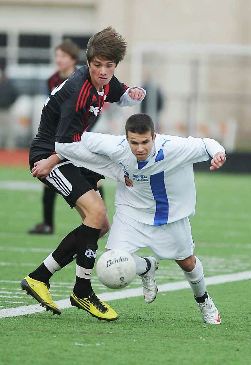 Bunnell's James Gillespie eyes the ball against New Canaan's Nicolas Deambrosio in the Class L boys soccer championship match at Fairfield Ludlowe High School in Fairfield, Conn. on Saturday November 20, 2010. New Canaan won the game 2-0.