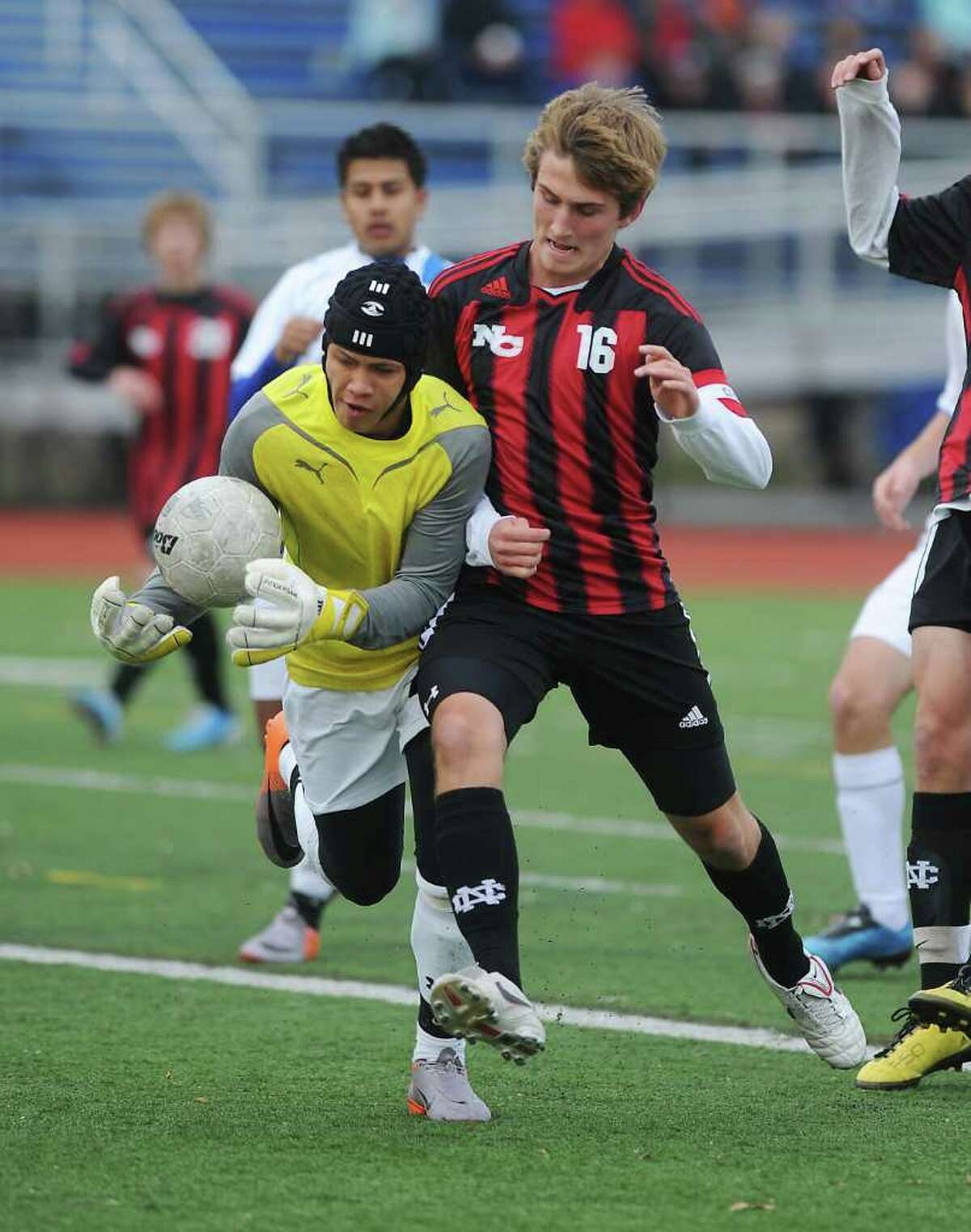 Bunnell's goalkeeper Christopher Fazekas makes a save against New Canaan's Scott O'Brien in the Class L boys soccer championship match at Fairfield Ludlowe High School in Fairfield, Conn. on Saturday November 20, 2010. New Canaan won the game 2-0.