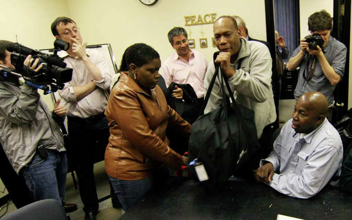 Joseph Borges, the Republican Registrar of Voters, places the bag of uncounted ballots in question in front of the counters and other officials at the Registrar of Voters Office inside McLevy Hall in downtown Bridgeport, Conn. on Thursday November 04, 2010.