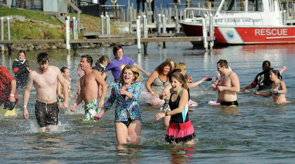 """""""Plungers"""" react to the cold waters of Lake George during the """"Polar Bear Plunge"""" to raise money for Special Olympics in Lake George. (Skip Dickstein/Times Union)"""