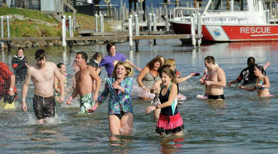 """Plungers"" react to the cold waters of Lake George during the ""Polar Bear Plunge"" to raise money for Special Olympics in Lake George. (Skip Dickstein/Times Union) Photo: Skip Dickstein"