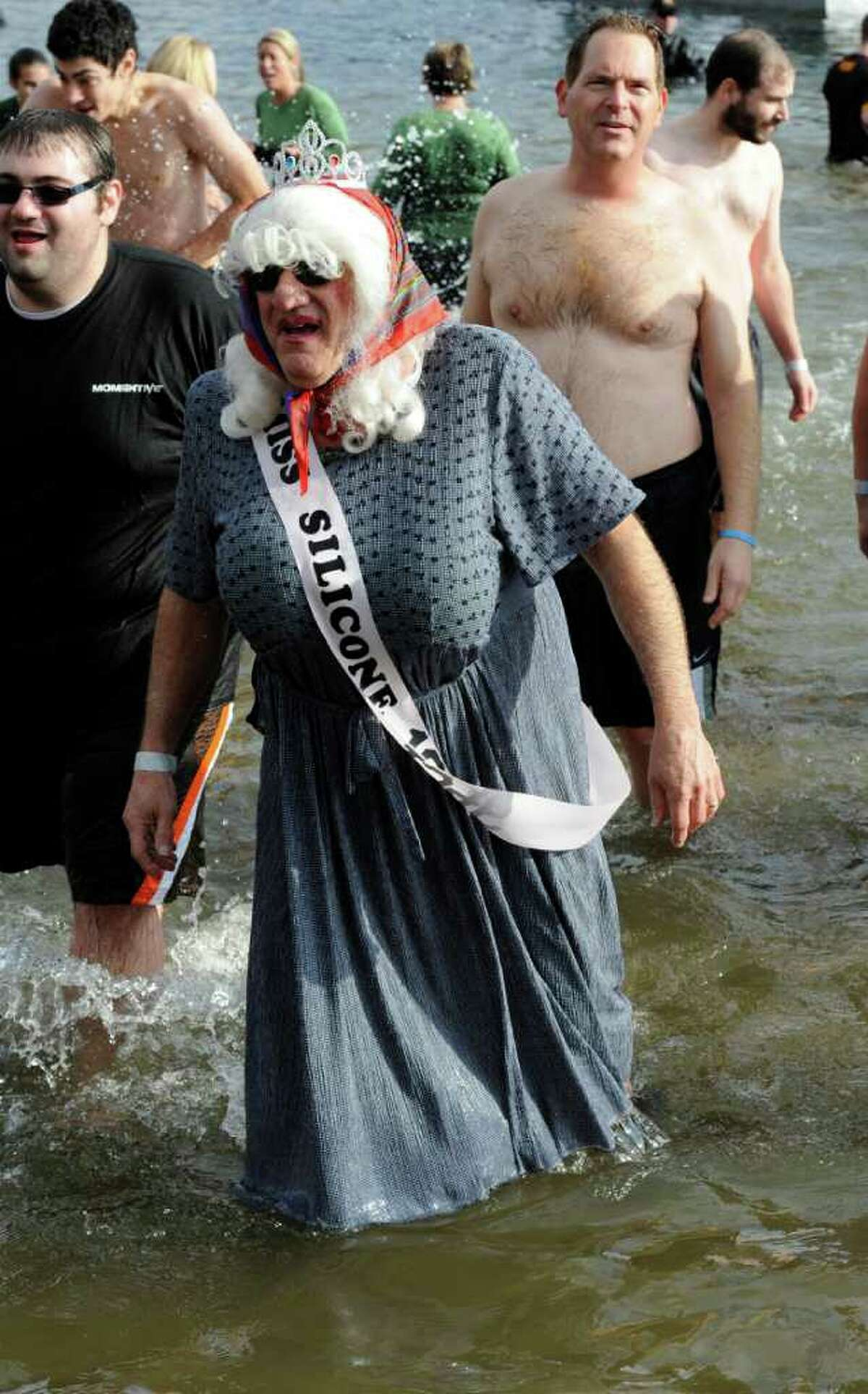 Wearing the sash of Miss Silicone 1949 is Ken Mavica who is fundraising with others from the Momentive Company while in the lake during the
