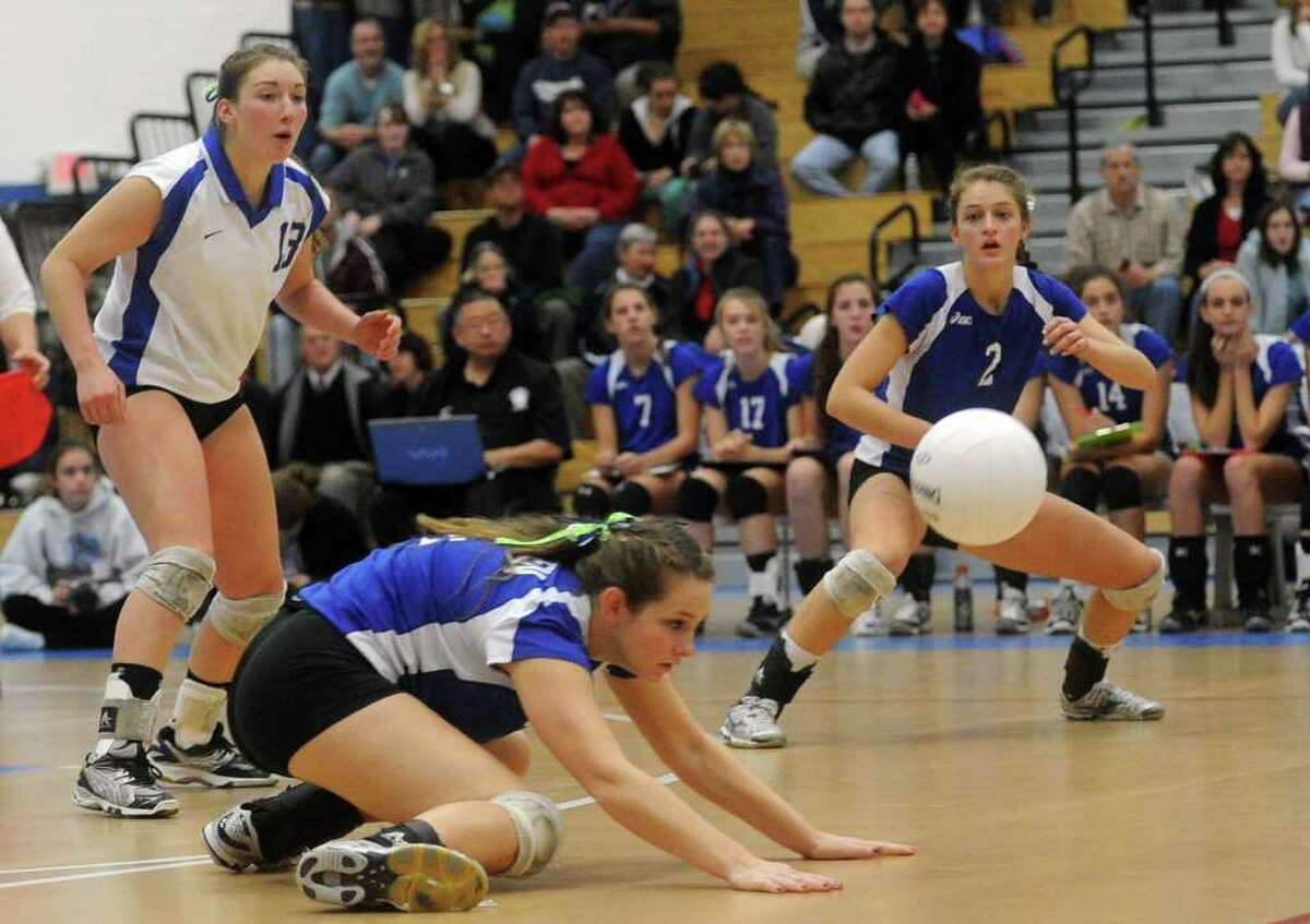 A ball escapes the reach of Darien's Mackenzie Begley during Saturday's Class L Volleyball Championship game against East Lyme at Glastonbury High School on November 20, 2010.