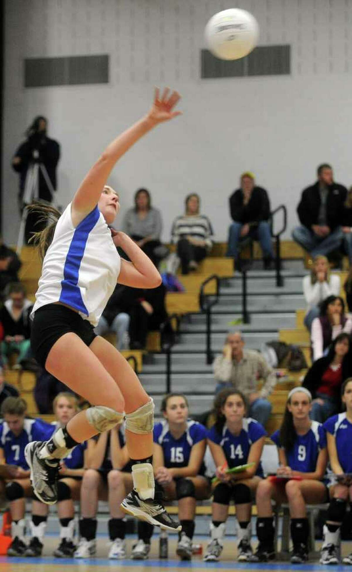 Darien's Bella Carrara spikes the ball during Saturday's Class L Volleyball Championship game against East Lyme at Glastonbury High School on November 20, 2010.