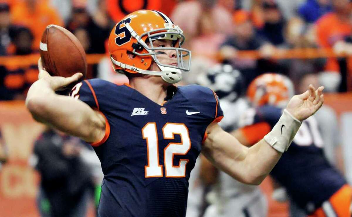 Syracuse's Ryan Nassib throws against Connecticut during the first quarter of an NCAA college football game in Syracuse, N.Y., Saturday, Nov. 20, 2010. (AP Photo/Kevin Rivoli)