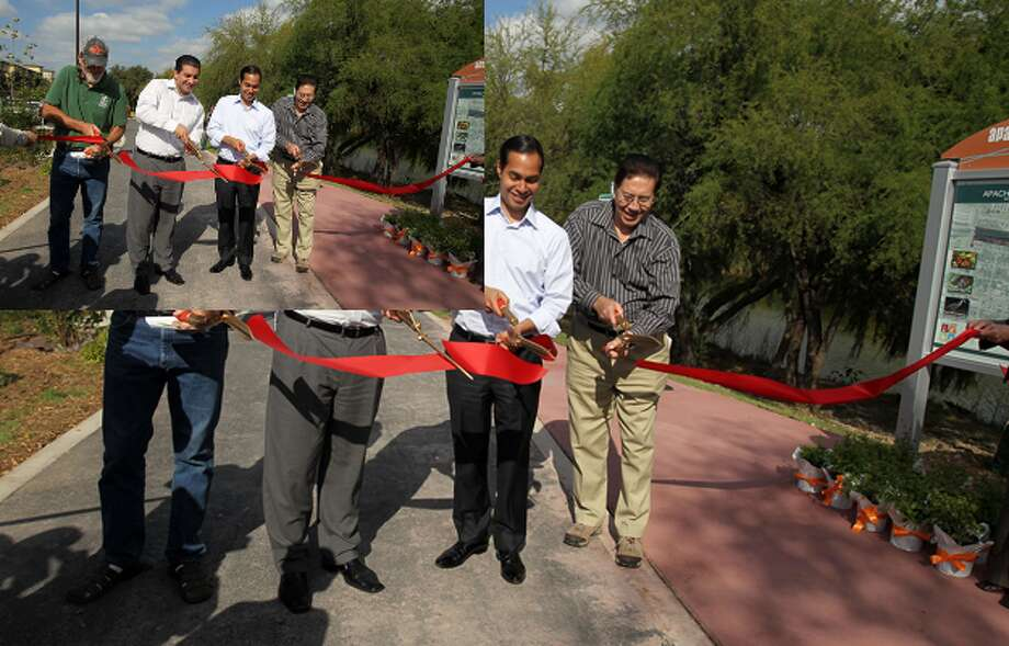 Rod Radle (from left), District 5 City Councilman David Medina, Mayor Julian Castro and Robert Rodriguez cut the ribbon to open the first trail on the West Side at the Dedication & Blessing of the Apache/Zarzamora Creeks Linear Park .