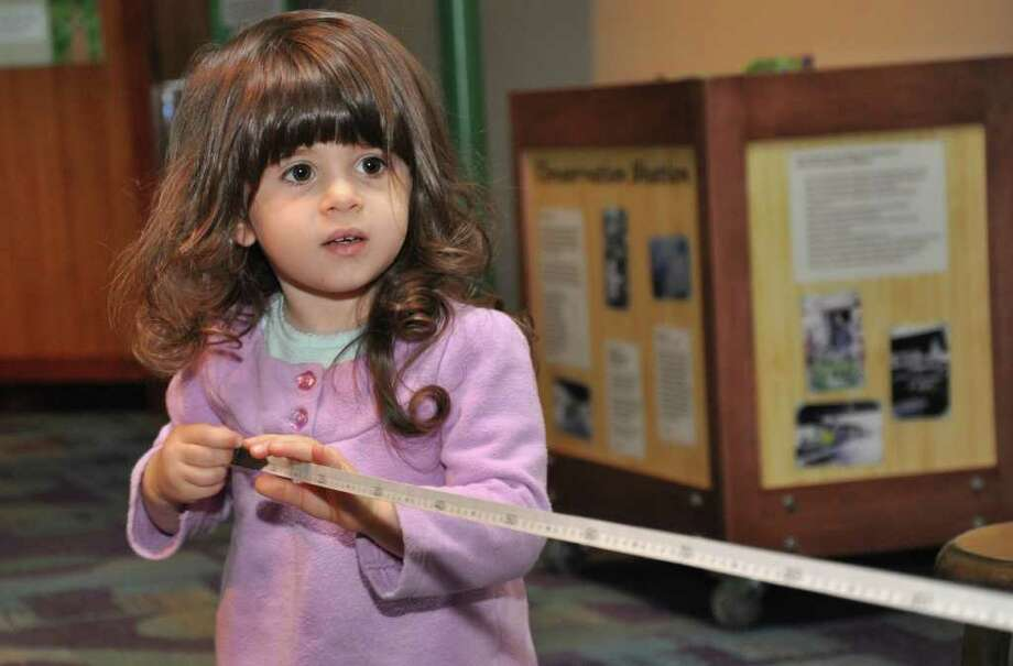 Giana Stracuzzi, 2.5, of Meriden, uses a measuring tape at Stepping Stones Museum for Children during the grand re-opening on Saturday, Nov. 20, 2010. Photo: Amy Mortensen / Connecticut Post Freelance