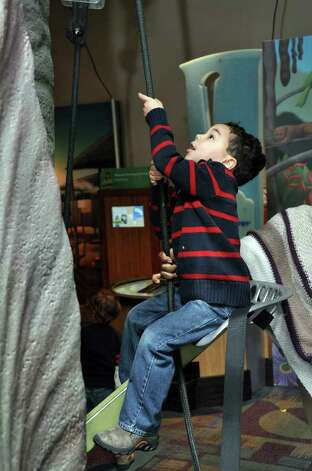 Remy Lipman, 5, of Bedford, NY; uses a pulley to hoist himself up at Stepping Stones Museum for Children during the grand re-opening on Saturday, Nov. 20, 2010. Photo: Amy Mortensen / Connecticut Post Freelance