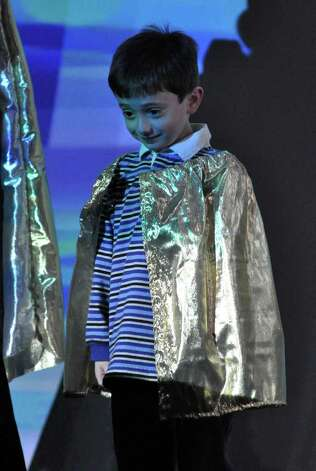 "Robert Koteen, 5, of Norwalk, plays the part of ""Ray"" during a skit about solar energy at Stepping Stones Museum for Children during the grand re-opening on Saturday, Nov. 20, 2010. Photo: Amy Mortensen / Connecticut Post Freelance"