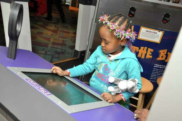 Kennedy Ferdinand, 3, of Norwalk, explores an interactive exhibit at Stepping Stones Museum for Children during the grand re-opening on Saturday, Nov. 20, 2010. Photo: Amy Mortensen / Connecticut Post Freelance