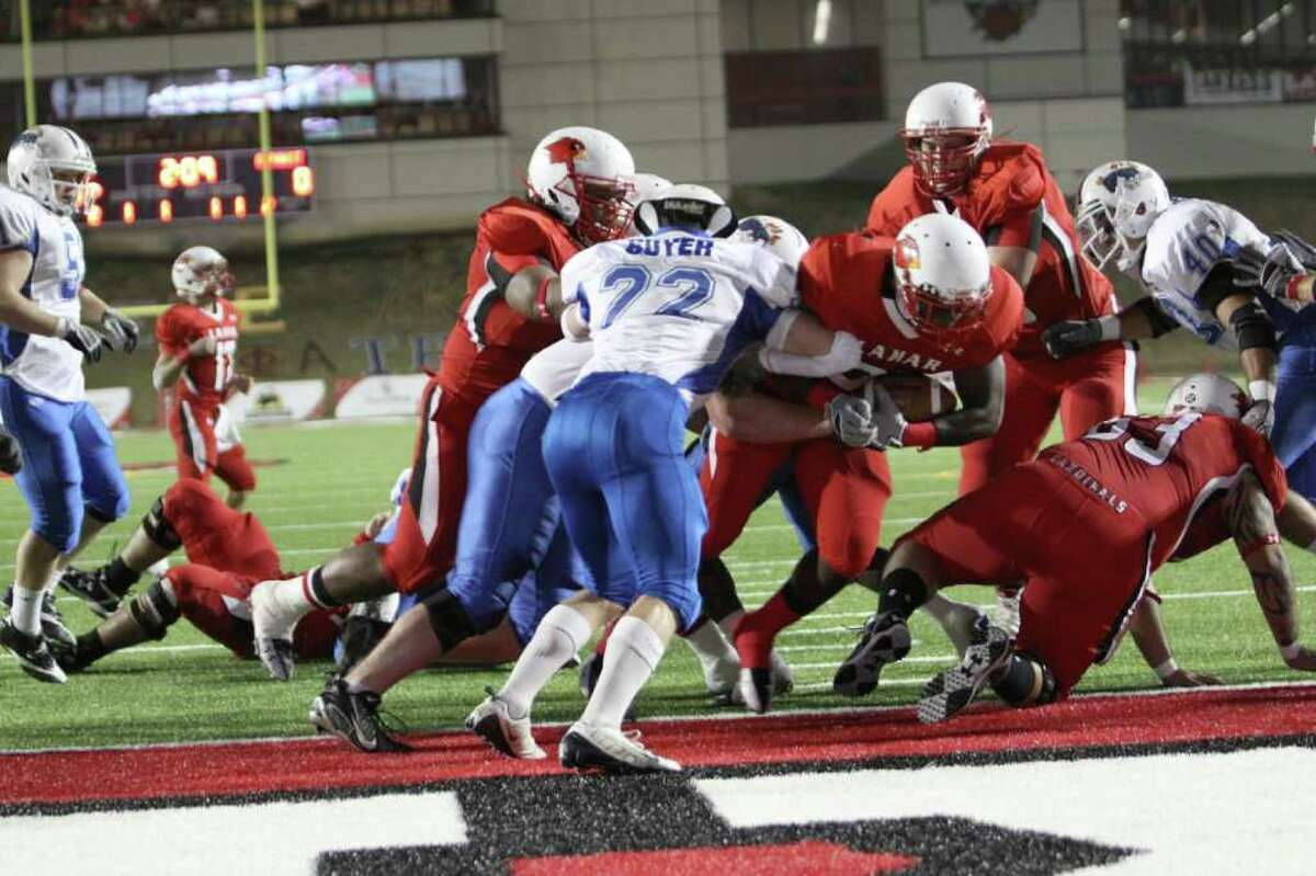 Kwabena Asante rushes for Lamar's first rushing touchdown of the 2010 football season Saturday night against Oklahoma Panhandle State in Provost Umphrey Stadium.
