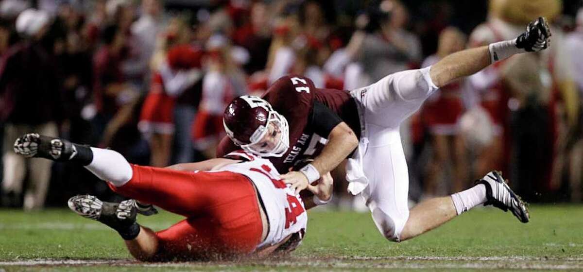 Texas A&M Aggies quarterback Ryan Tannehill (17) is rolled up and sacked in the third quarter by Nebraska Cornhuskers defensive tackle Jared Crick (94) at Kyle Field, Saturday, November 20, 2010. The Aggies won on a field goal 9-6. (Tom Fox/The Dallas Morning News) 2nd Half