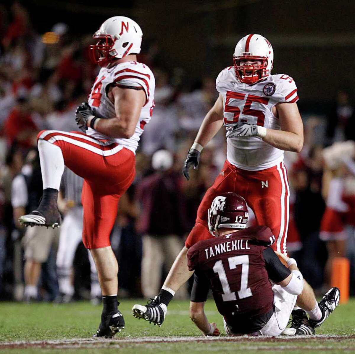 Nebraska Cornhuskers defensive tackle Jared Crick (94) and defensive tackle Baker Steinkuhler (55) celebrate Cricks sacjk of Texas A&M Aggies quarterback Ryan Tannehill (17) in the third quarter by at Kyle Field, Saturday, November 20, 2010. The Aggies won on a field goal 9-6. (Tom Fox/The Dallas Morning News) 2nd Half