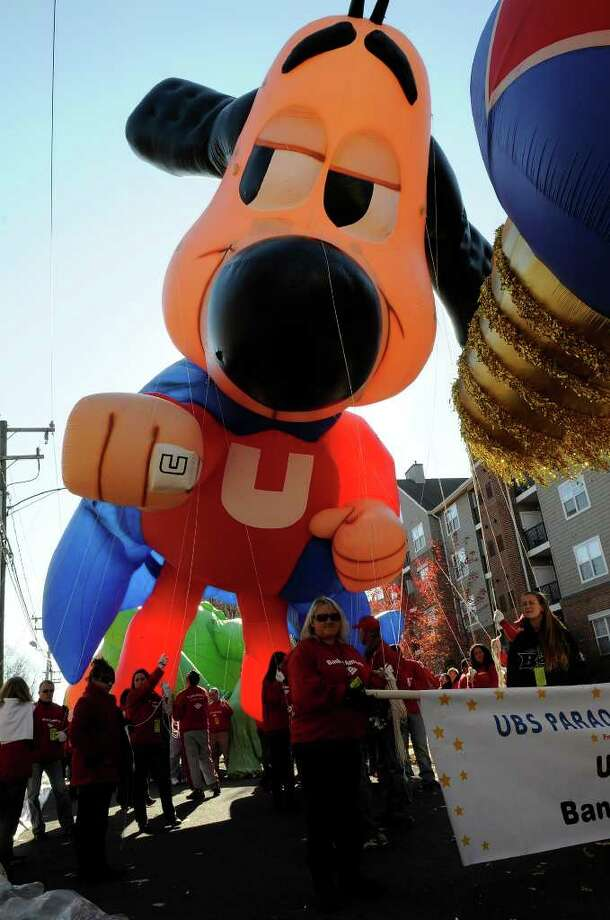 Volunteer balloon handlers get the Underdog balloon ready for the UBS Parade Spectacular in downtown Stamford on Sunday, November 21, 2010. Photo: Shelley Cryan / Shelley Cryan freelance; Stamford Advocate Freelance