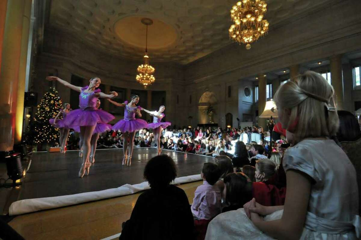 Olivia McLeron of Schenectady, 8, right, watches the Northeast Ballet Company perform excerpts from The Nutcracker during the Nutcracker Tea 2010 at the Hall of Springs at Saratoga Spa State Park in Saratoga Springs, Sunday, Nov. 21. The annual event, which attracted 800 children and guests over two session, is sponsored by Emma Willard School and hosted by SPAC's Action Council.( Philip Kamrass / Times Union