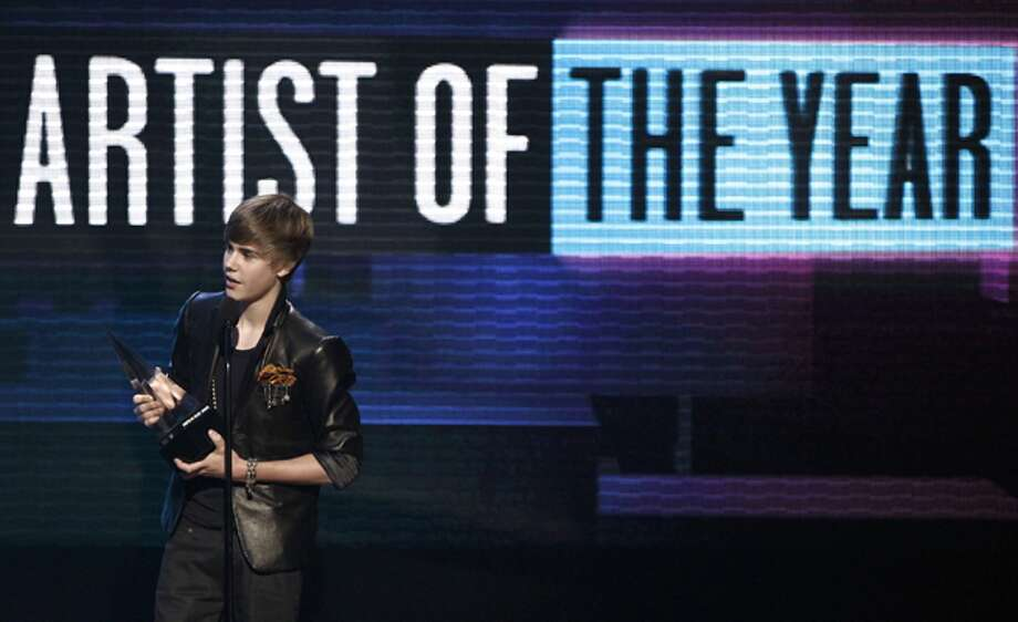 Justin Bieber accepts the award for artist of the year at the 38th Annual American Music Awards on Sunday.