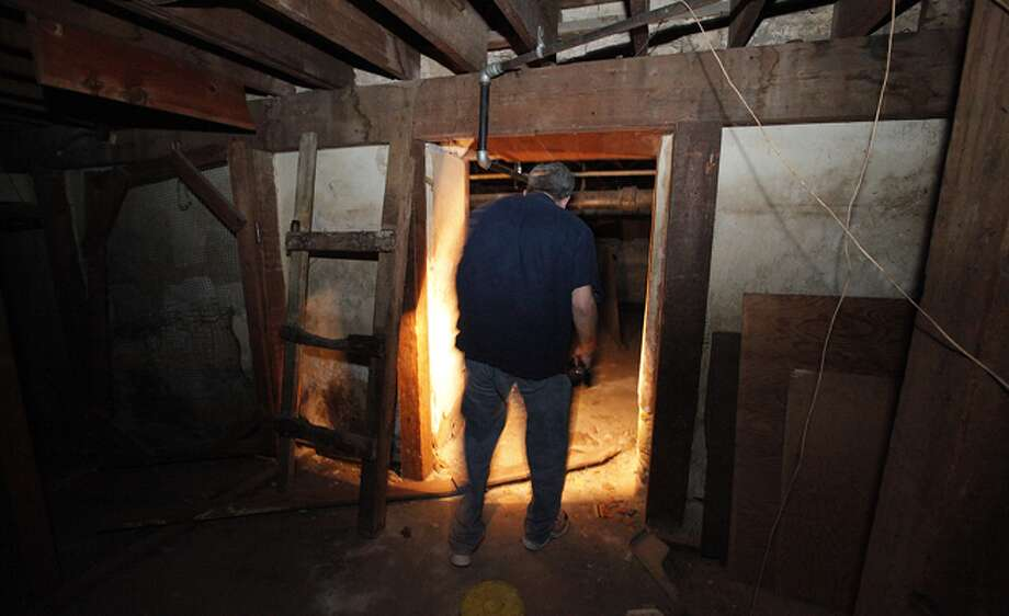 Express-News columnist Scott Stroud explores the basement at 111 S. Flores St., the site of a shop once run by gunsmith Hyman S. Lebman.