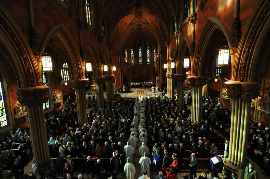 A processional walk to the altar is part of the rededication Sunday at the Cathedral of the Immaculate Conception. A Mass was celebration following extensive renovations to the interior and exterior of the 158-year-old building.  ( Philip Kamrass / Times Union ) Photo: Philip Kamrass