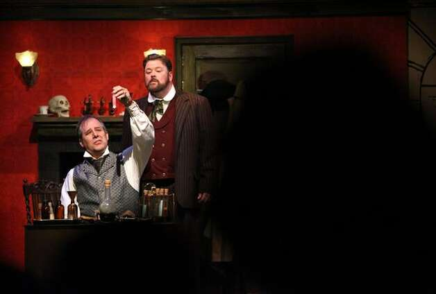 "Terry Edward Moore, left, playing Sherlock Holmes, and Stephen Grenley, playing the role of Watson, perform during the first preview showing of ""Sherlock Holmes and the Case of the Christmas Carol"" at the Taproot Theater. The play was originally scheduled in 2009 but an arson fire forced the theater to cancel the show. Photo: Joshua Trujillo/seattlepi.com"