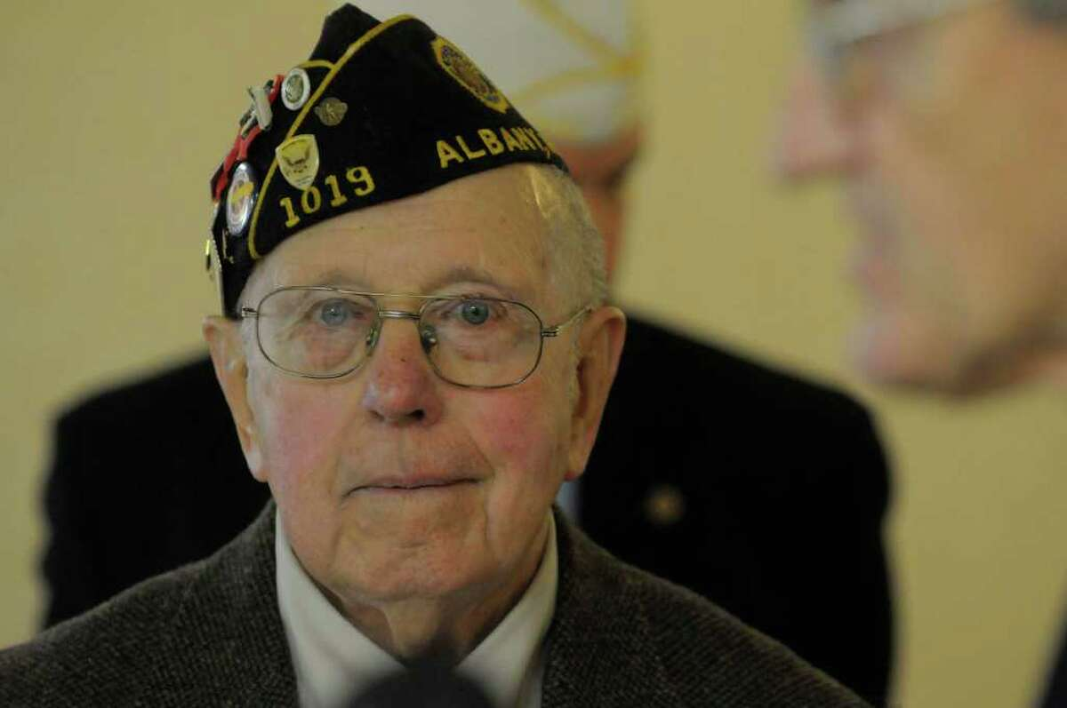 World War II veteran Army Pfc. Anthony Schmitz listens as an account of his heroic actions during the war were read aloud Sunday during a ceremony put on by the Disabled American Veterans, Chapter 38, at the Veterans of Lansingburgh in Troy. Schmitz received his Bronze Star Medal for Merit. (Paul Buckowski / Times Union)