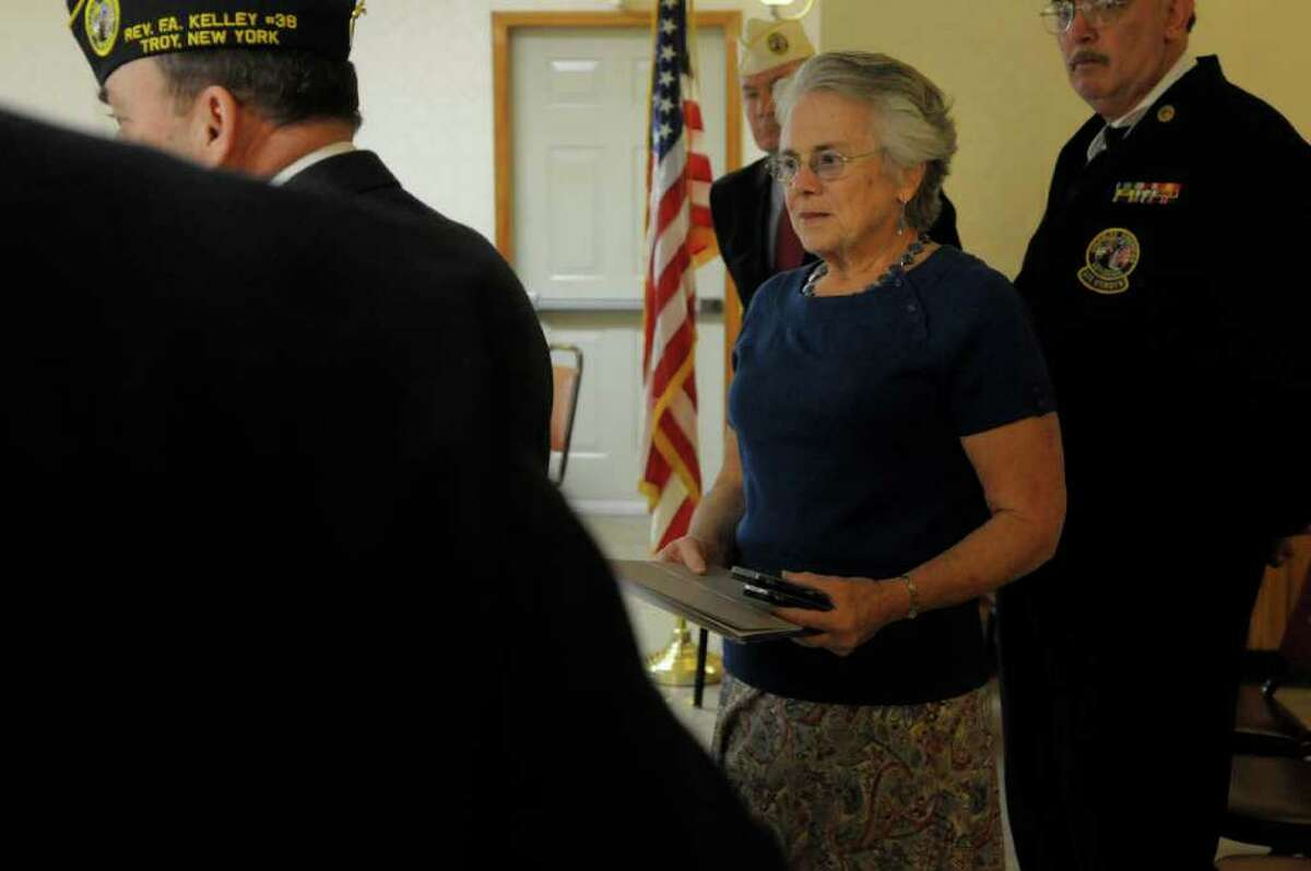 Carolyn Parisi, widow of World War II Army Cpl. Vincent Parisi, listens as an account of his service was read aloud Sunday during a ceremony put on by the Disabled American Veterans, Chapter 38. Parisi posthumously was awarded the New York State Conspicuous Service Cross and Star and the Belgian Fourragere. (Paul Buckowski / Times Union)