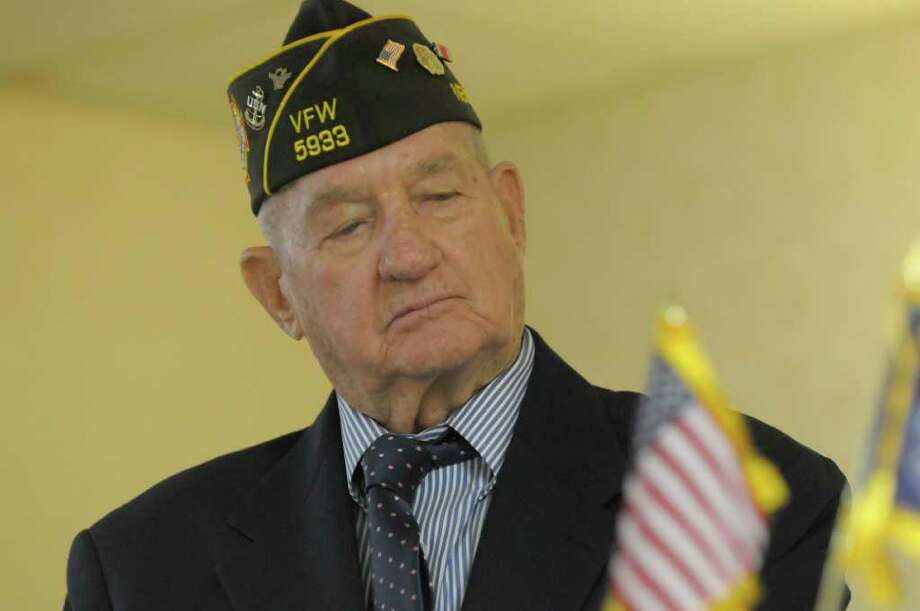 World War II veteran Navy Fireman 1st Class Russell Graham listens as an account of his service was read aloud during a ceremony Sunday put on by the Disabled American Veterans, Chapter 38. The ceremony, held at the Veterans of Lansingburgh in Troy, was held to award earned medals to veterans who had never received them.  Graham recevied the Navy Combat Action Ribbon and the New York State Medal for Merit.   (Paul Buckowski / Times Union) Photo: Paul Buckowski / 00011156A