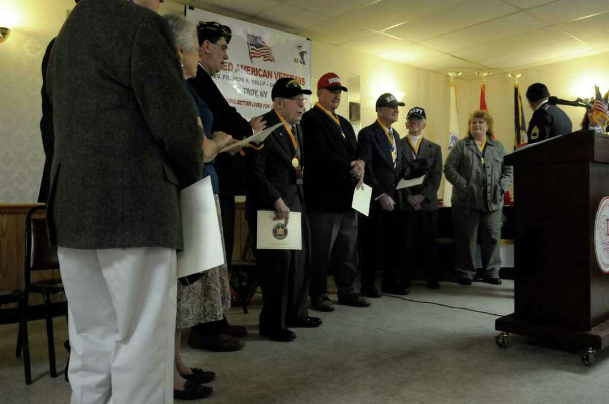 Veterans and the widows of veterans receive applause near the conclusion of the awards ceremony Sunday at the Veterans of Lansingburgh in Troy. (Paul Buckowski / Times Union)