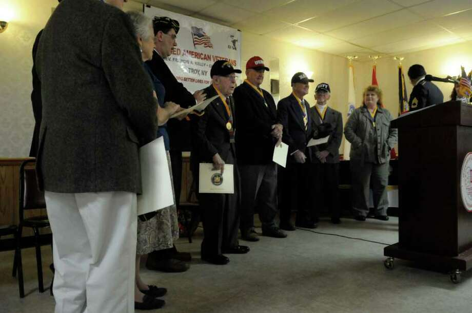 Veterans and the widows of veterans receive applause near the conclusion of the awards ceremony Sunday at the Veterans of Lansingburgh in Troy.  (Paul Buckowski / Times Union) Photo: Paul Buckowski / 00011156A