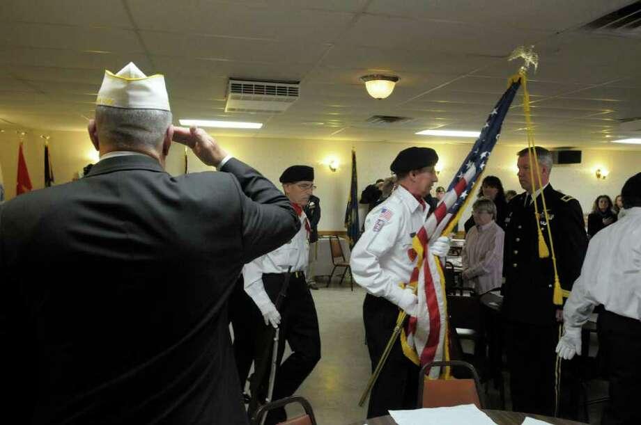 Veterans of Lansingburgh Color Guard members retire the colors Sunday at the Veterans of Lansingburgh. (Paul Buckowski / Times Union) Photo: Paul Buckowski / 00011156A