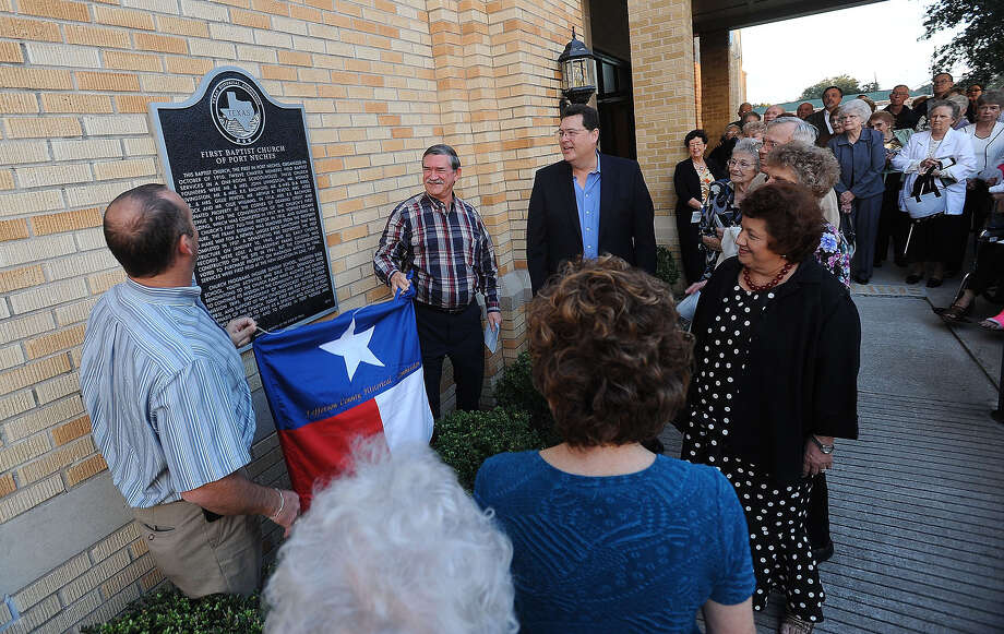 Parishioners of the First Baptist Church of Port Neches gather Sunday to witness the the unvailing of a historical marker to commemorate the church's 100 year history. Guiseppe Barranco/The Enterprise