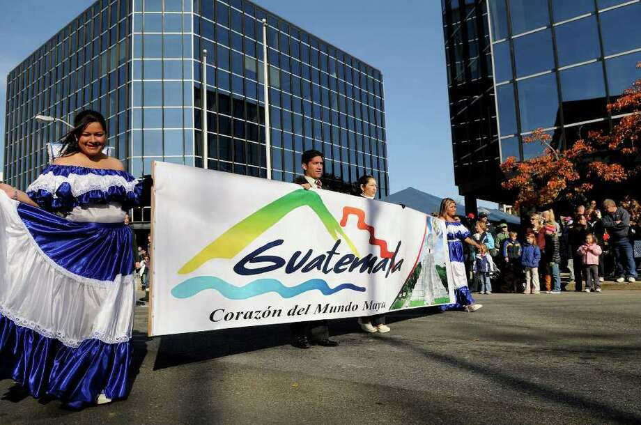 A group from Guatemala joins the UBS Parade Spectacular in downtown Stamford  Sunday, Nov. 21, 2010. Photo: Shelley Cryan, ST / Shelley Cryan freelance; Stamford Advocate Freelance