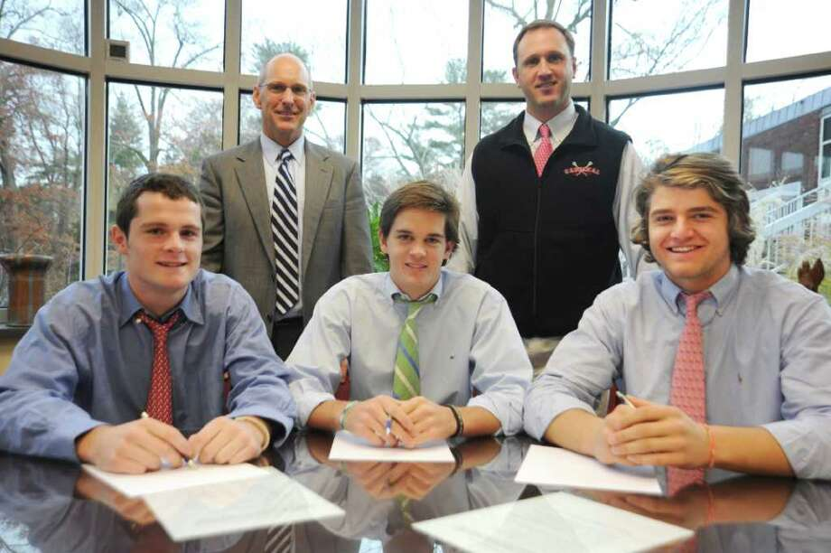 Greenwich High School lacrosse players signing letters of intent, from left, Stephen Dodd, Fairfield University; David Dickson, Bucknell University; and Adam Sands, Leigh University; on Monday, Nov. 22, 2010.  Behind the athletes, Christopher Winters, Greenwich High School headmaster, left, and lacrosse coach Scott Bulkley. Photo: Helen Neafsey / Greenwich Time