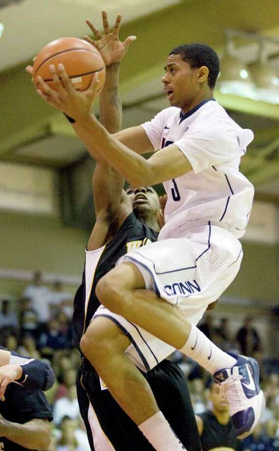 Connecticut's Jeremy Lamb (3) flies in for a lay up while playing against Wichita State in the first half of an NCAA college basketball game  during the Maui Invitational in Lahaina,Hawaii Monday, Nov. 22, 2010. (AP Photo/Eugene Tanner) Photo: AP