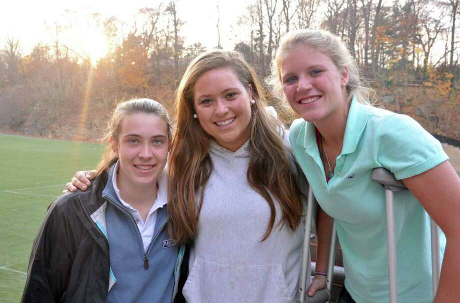 Greenwich Academy field hockey captains Kathryn Stack, Catie Schmidt and Meghan Duff pose for a photograph as the sun sets over the field hockey field at GA on Monday, Nov. 22, 2010. Photo: Amy Mortensen / Connecticut Post Freelance